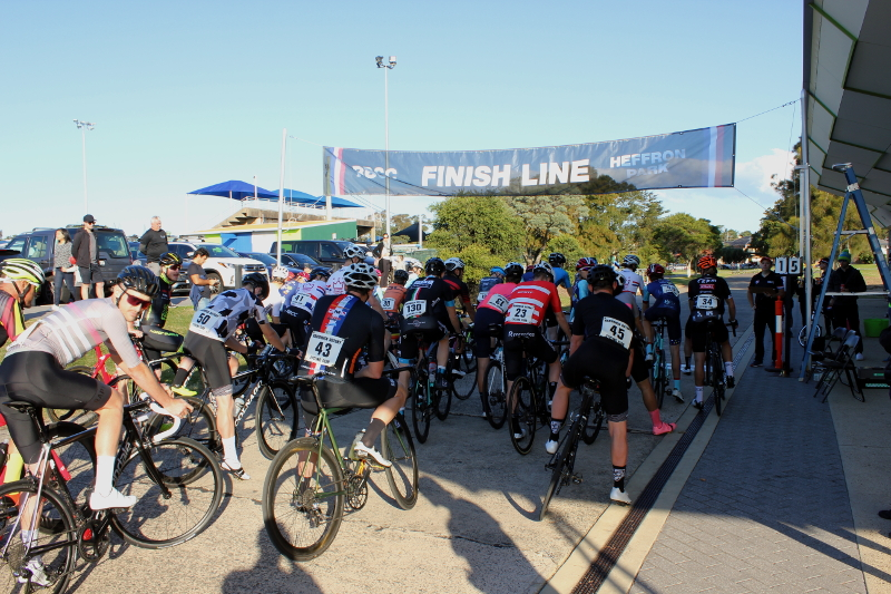 A Grade bicycle racers behind the start line at Heffron Park