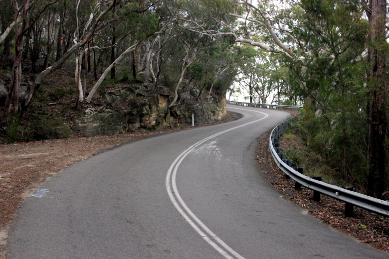 The road curves in an S shape before the end of Bobbin Head Climb.
