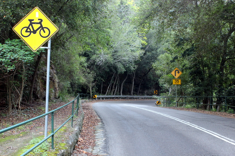 Bicycle road sign before a right hand hairpin to start the Bobbin Head West climb