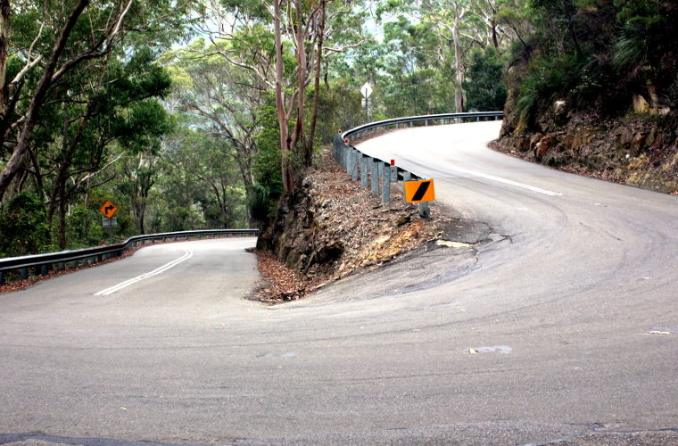 A steep-looking left-hand hairpin turn on the Galston Gorge East climb.