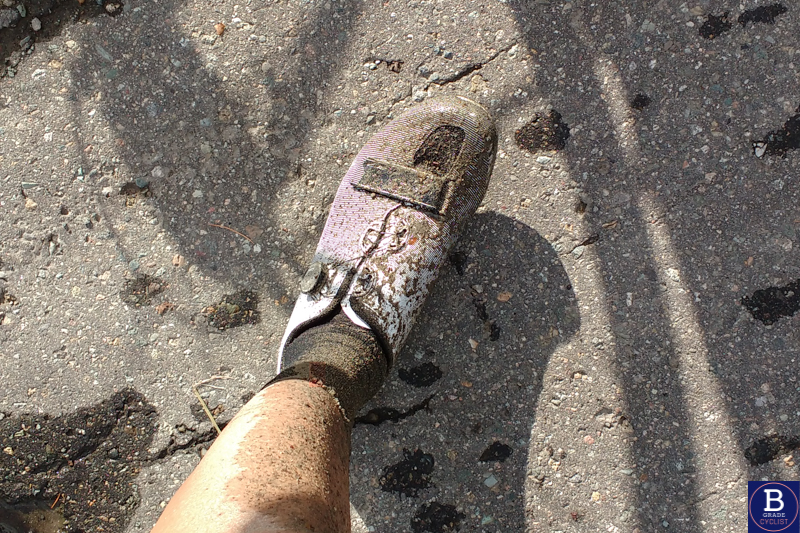 Muddy shoe after cycling in Akita, Japan on gravel roads during autumn