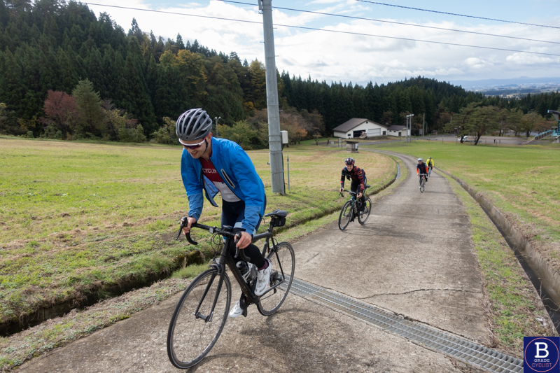 Matt de Neef climbing up the Ohdai Ski Resort climb while cycling in Akita, Japan.