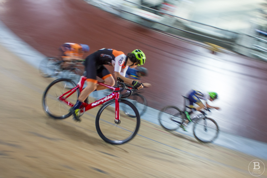 Cyclists on the banking of Dunc Gray Velodrome cycling track