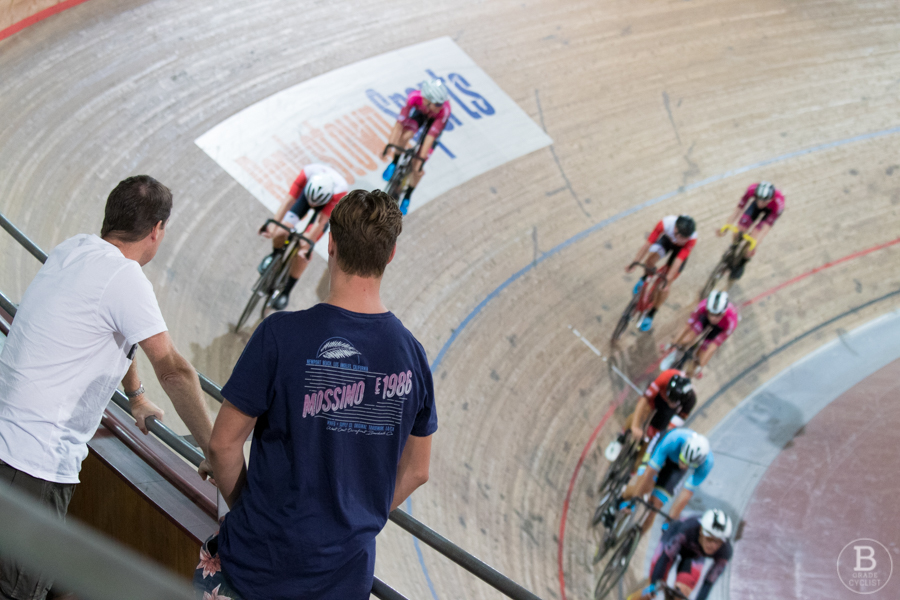 Spectators watching a track cycling race at Dunc Gray Velodrome.