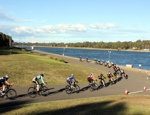 Cyclists strung out on the final corner of Sydney International Regatta Centre, Penrith