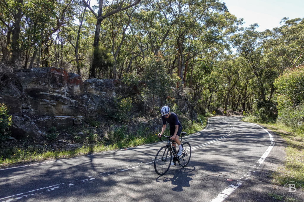 Cyclist near the top of the Waterfall Hill climb in Royal National Park