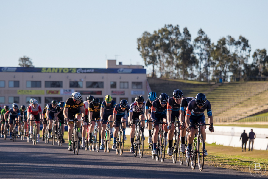 Cyclists in a line slipstreaming each other during a race.