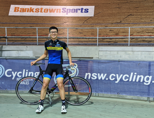 Ryan Miu with track bike after riding 100 laps with Bankstown Sports Cycling Club at Dunc Gray Velodrome