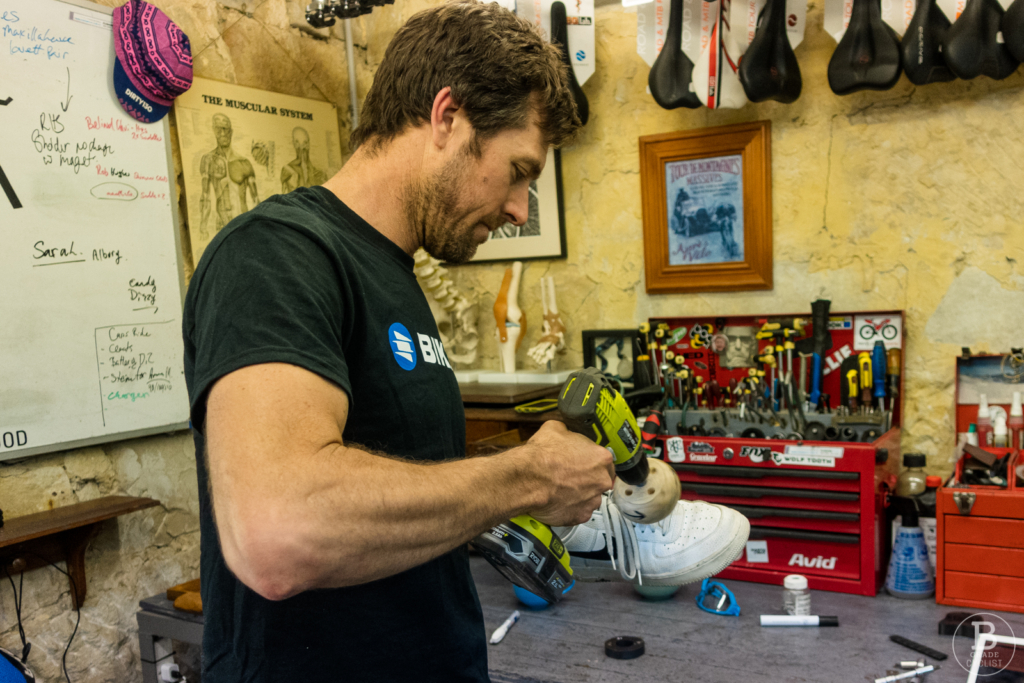 Aaron Dunford using magnets on a power drill as part of his bike fit method at Fusion Peak.