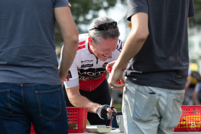Northern Sydney Cycling Club rider signing on at Beaumont Road race course