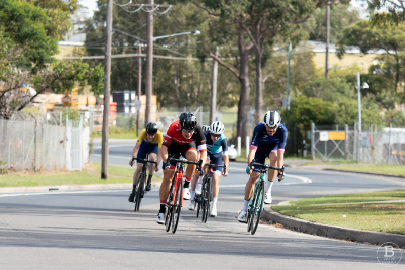 Cyclists sprinting to the finish line at Beaumont Road, Mount Kuring-gai.