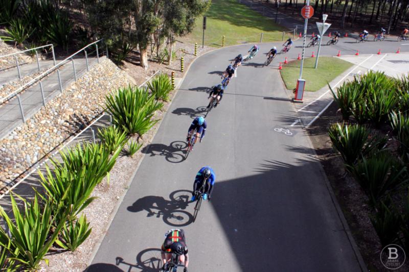 Cyclists in a line riding through a corner at Sydney International Regatta Centre, Penrith