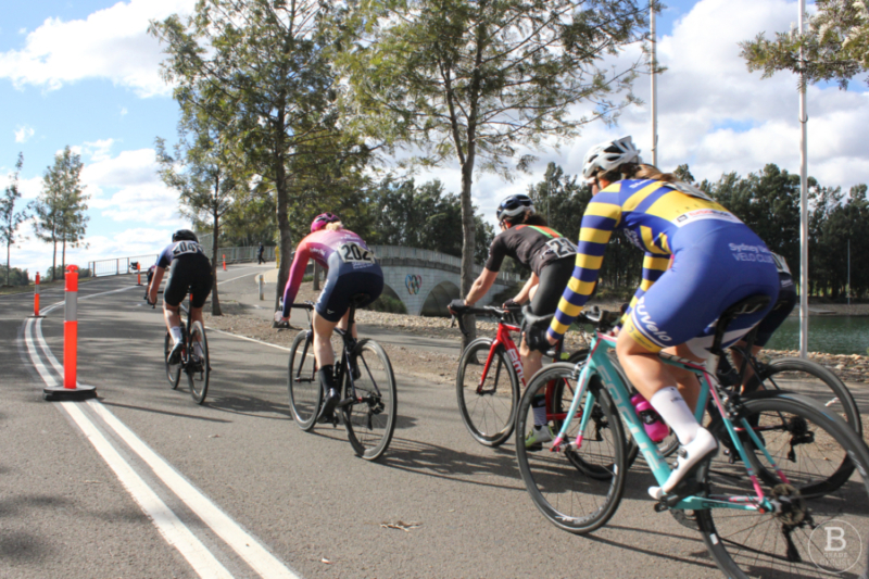 Women cyclists approaching the bridge at Sydney International Regatta Centre, Penrith